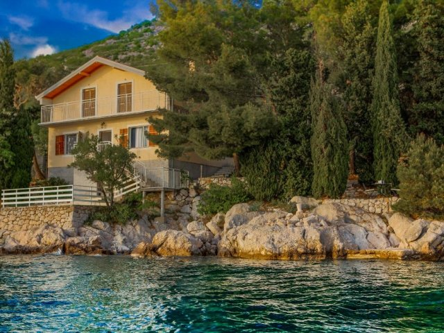 House on the sea vith private beach